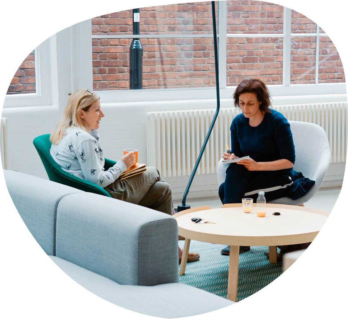 A work place discussion between two women