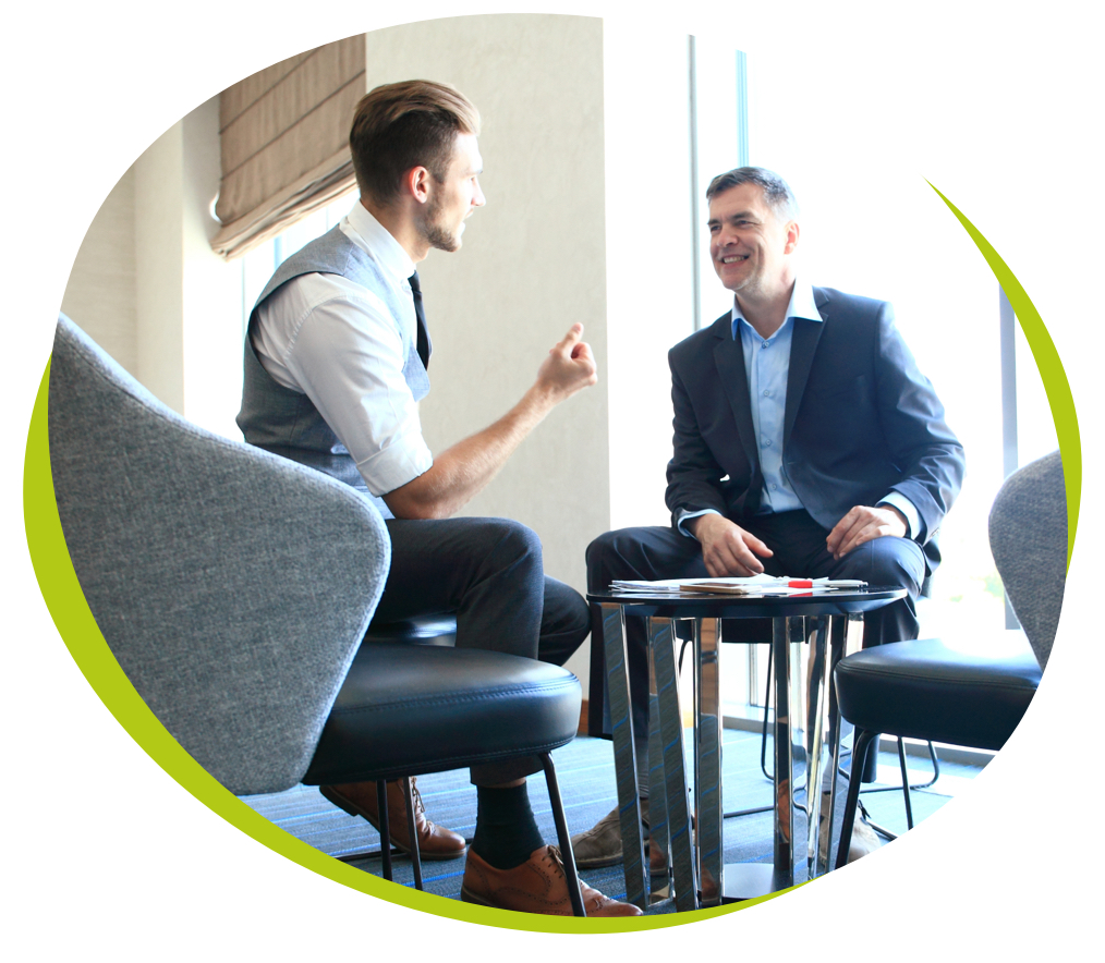 A workplace discussion between two men